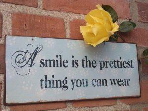 smil og verden smiler igen